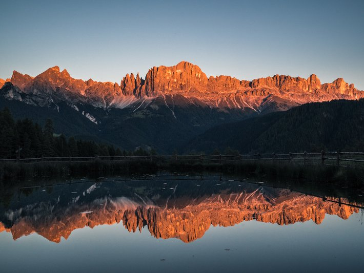 Autumnal sunset in Carezza